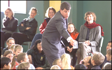 The author, in the role of his pen name Lemony Snicket, entertains at Milford Primary School last July. Picture / Paul Estcourt